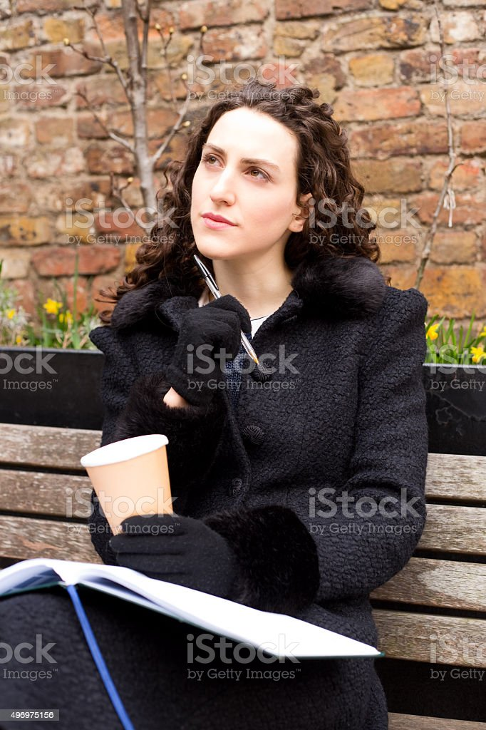 thoughtful girl with her diary and coffee royalty-free stock photo