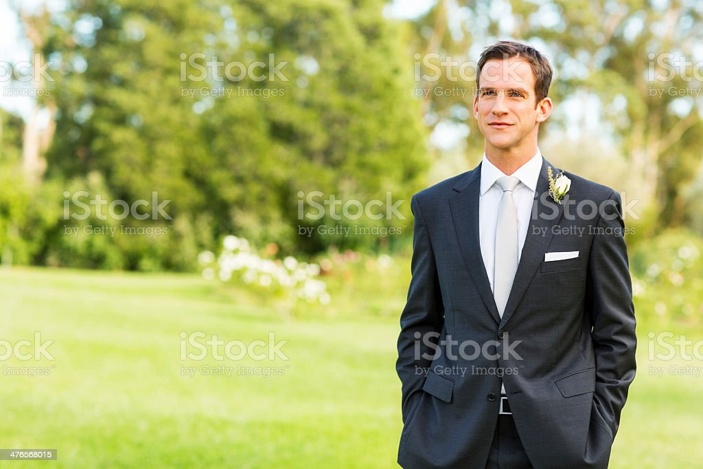 Thoughtful Groom Looking Away In Garden royalty-free stock photo