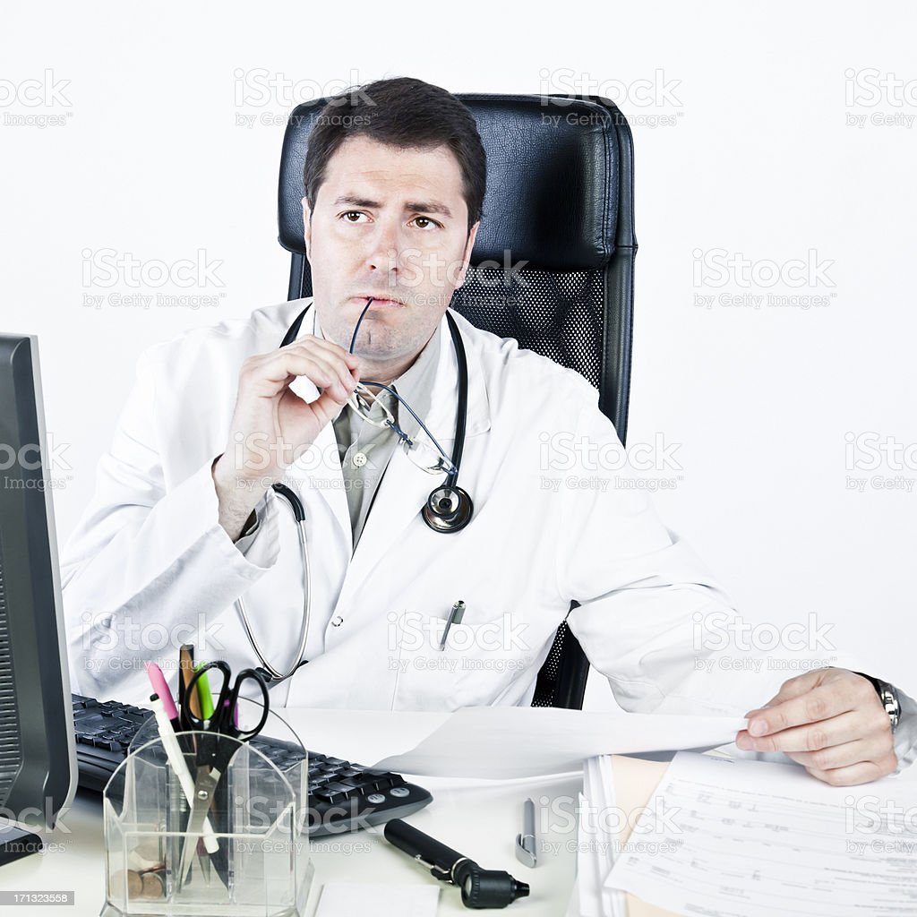 Thoughtful male doctor royalty-free stock photo