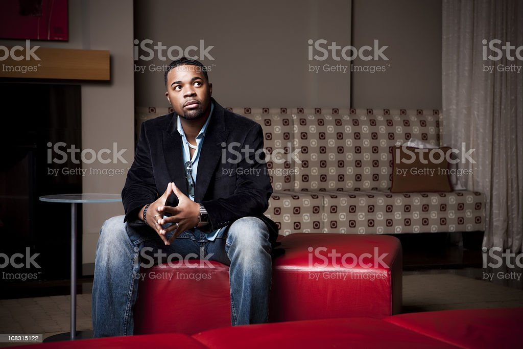 Thoughtful Male Sitting Alone royalty-free stock photo