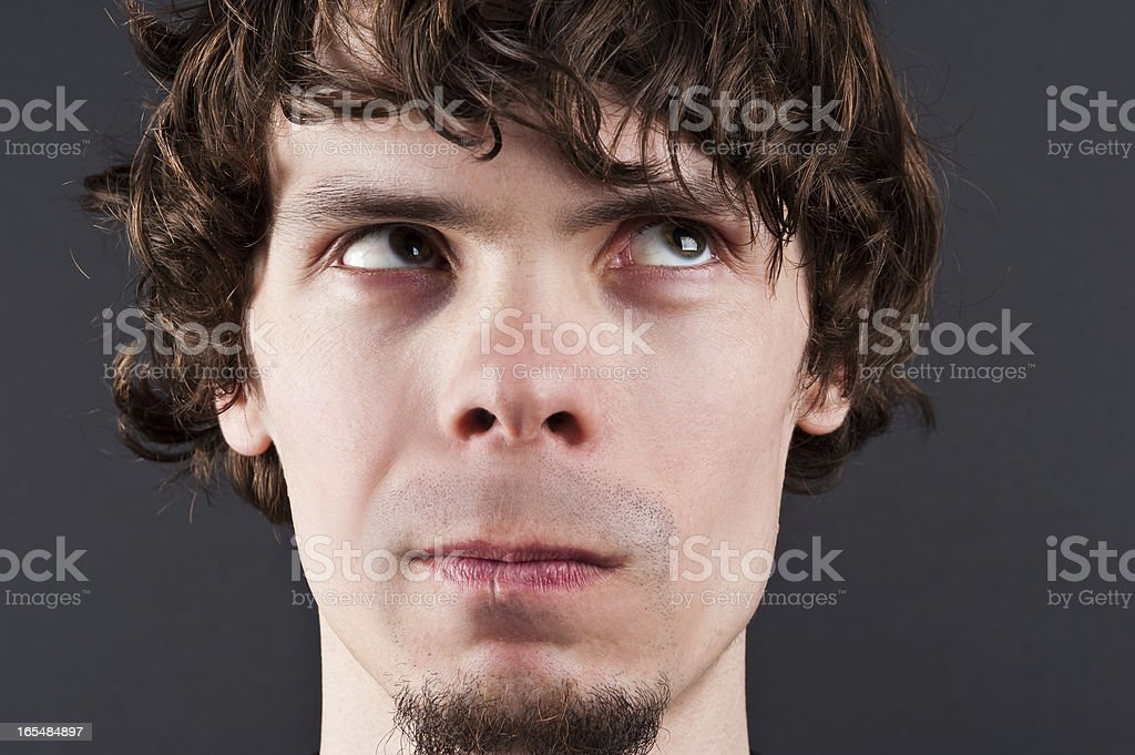 thoughtful man curly royalty-free stock photo