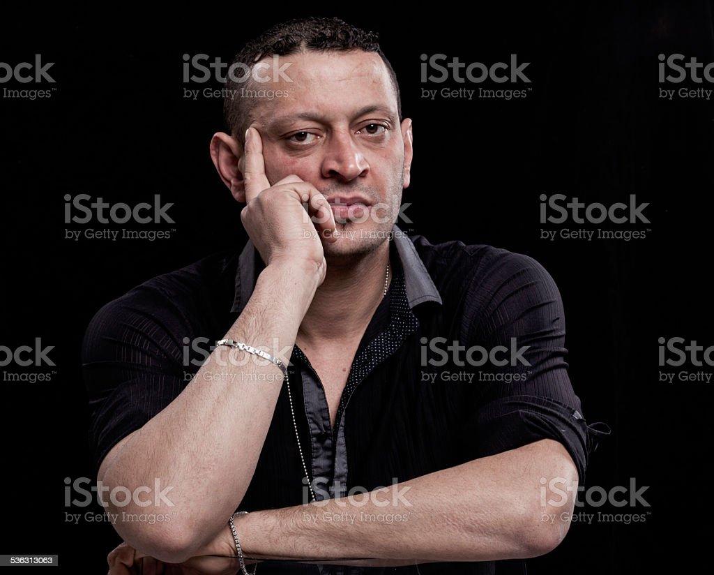 Thoughtful man portrait stock photo