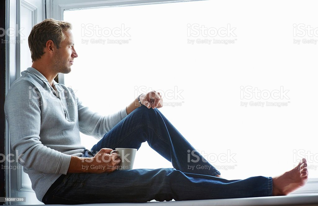 Thoughtful man with coffee stock photo