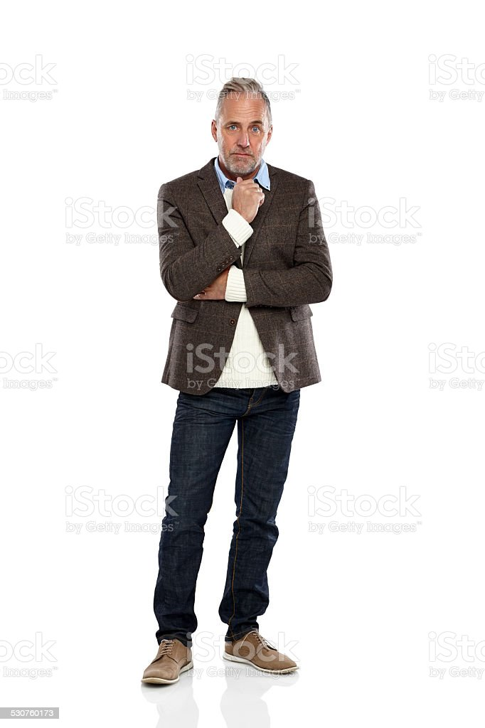Thoughtful mature man looking at camera stock photo