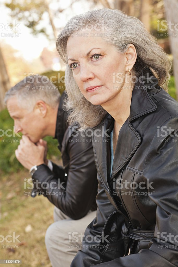 Thoughtful Mature Woman and Her Spouse, Having Problems royalty-free stock photo