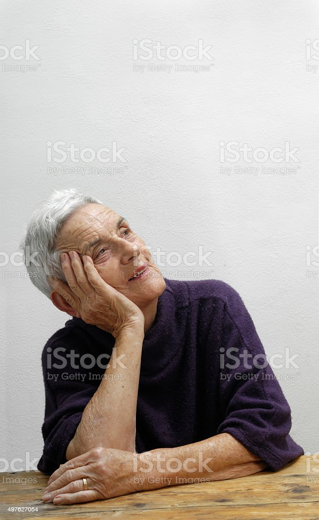 Thoughtful old woman happy, stock photo