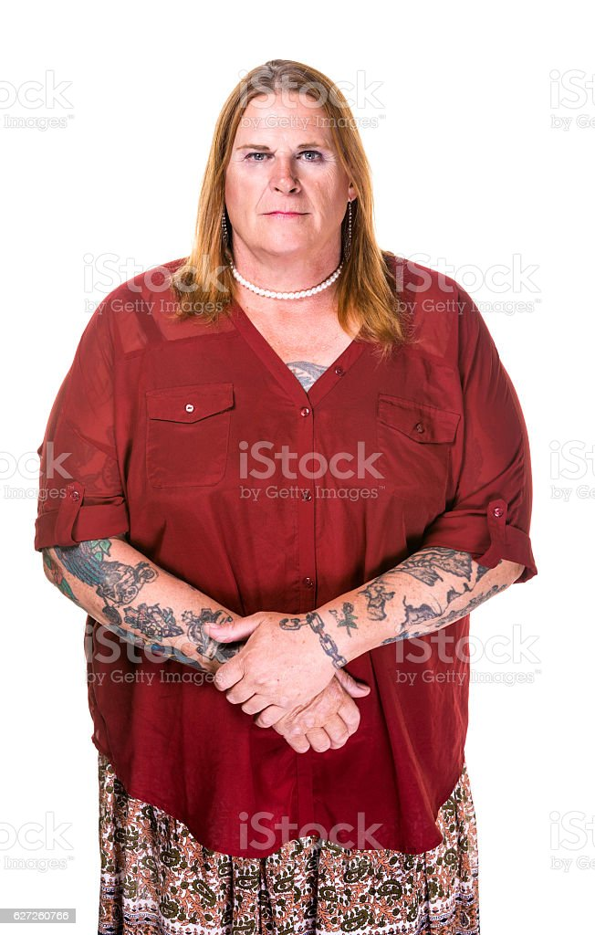 Thoughtful or Stern Transgender Woman in Pearl Necklace stock photo