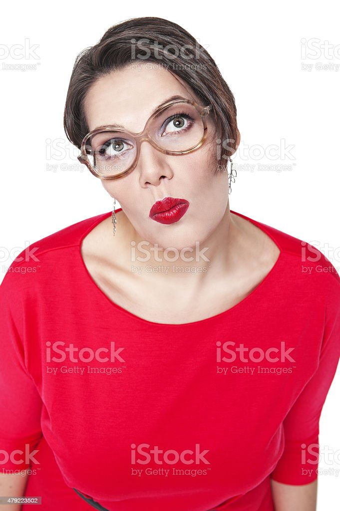 Thoughtful plus size woman in glasses looking on something up stock photo