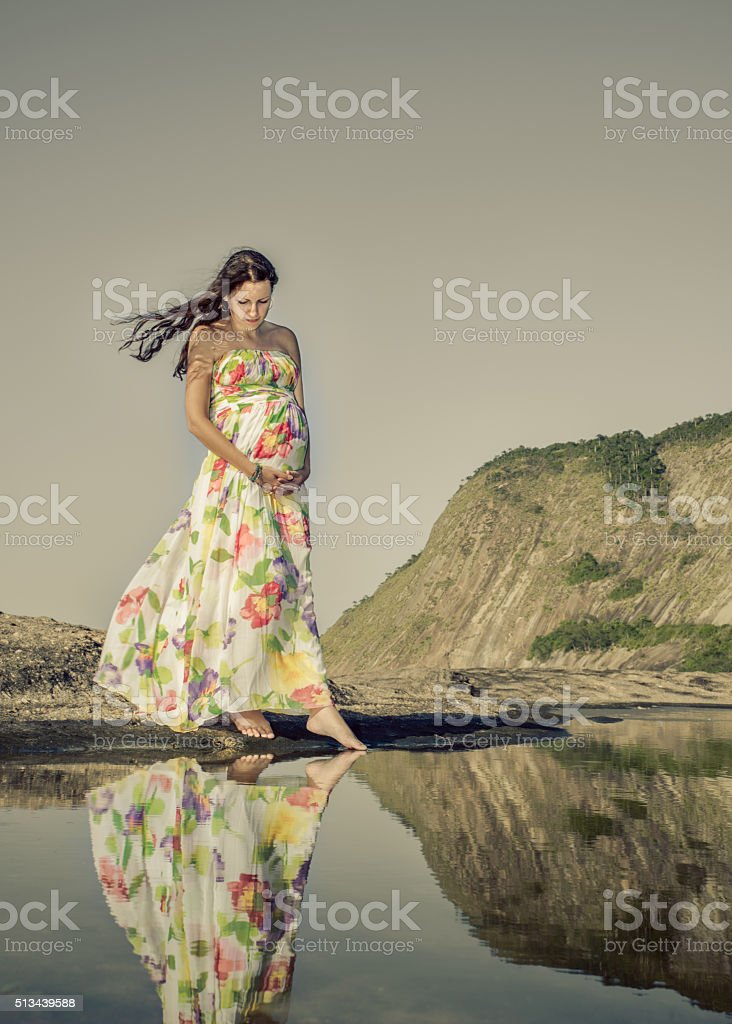 Thoughtful pregnant lady wearing a formal dress royalty-free stock photo