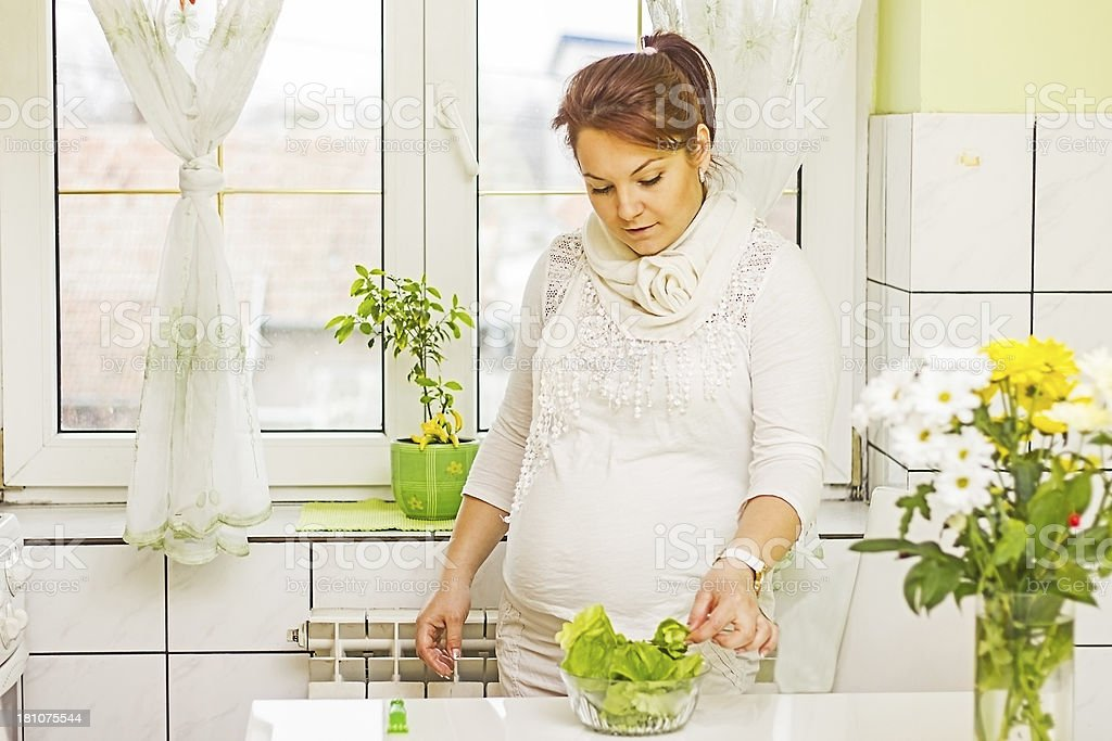 Thoughtful pregnant woman with  salad. royalty-free stock photo