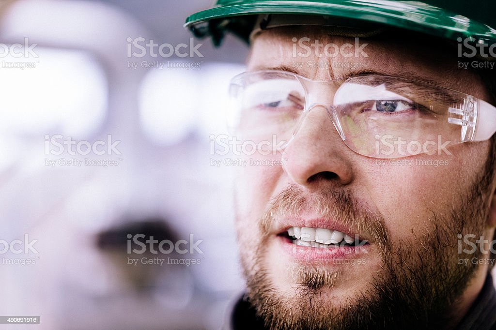 Thoughtful professional wearing protective eyewear stock photo