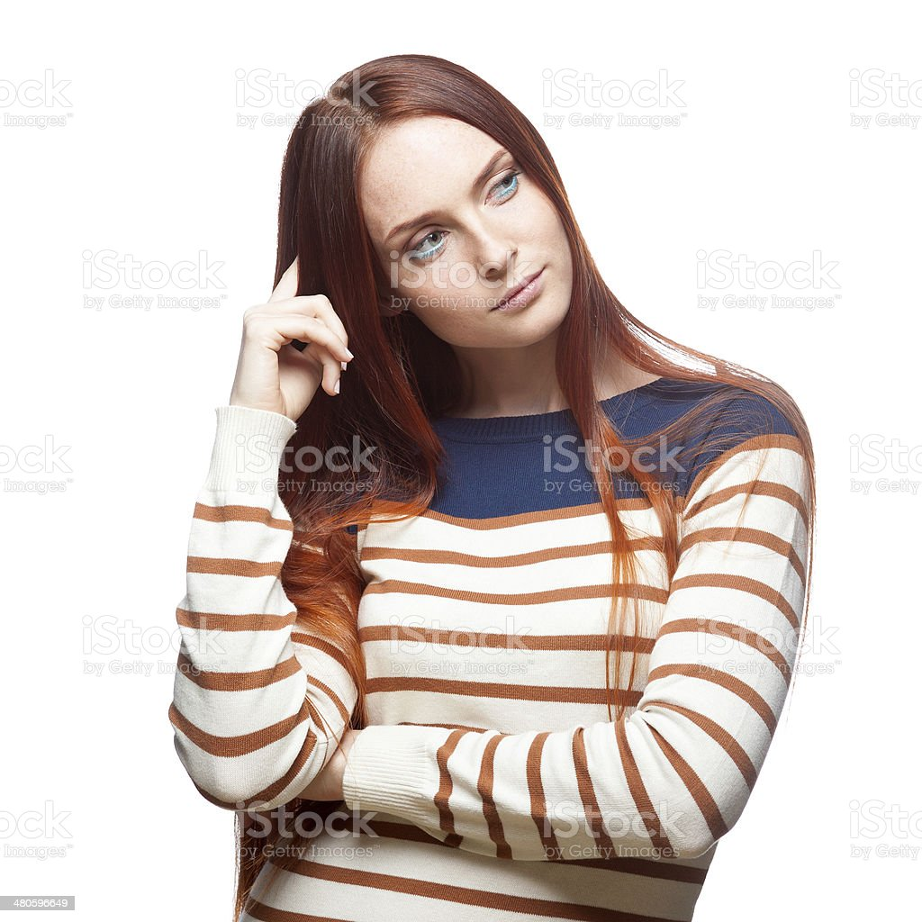 thoughtful red haired girl stock photo