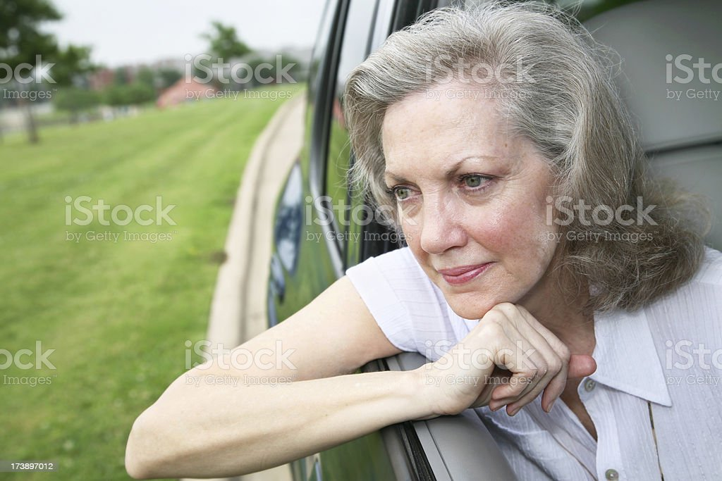 Thoughtful Senior Adult Woman Waiting in Her Car royalty-free stock photo