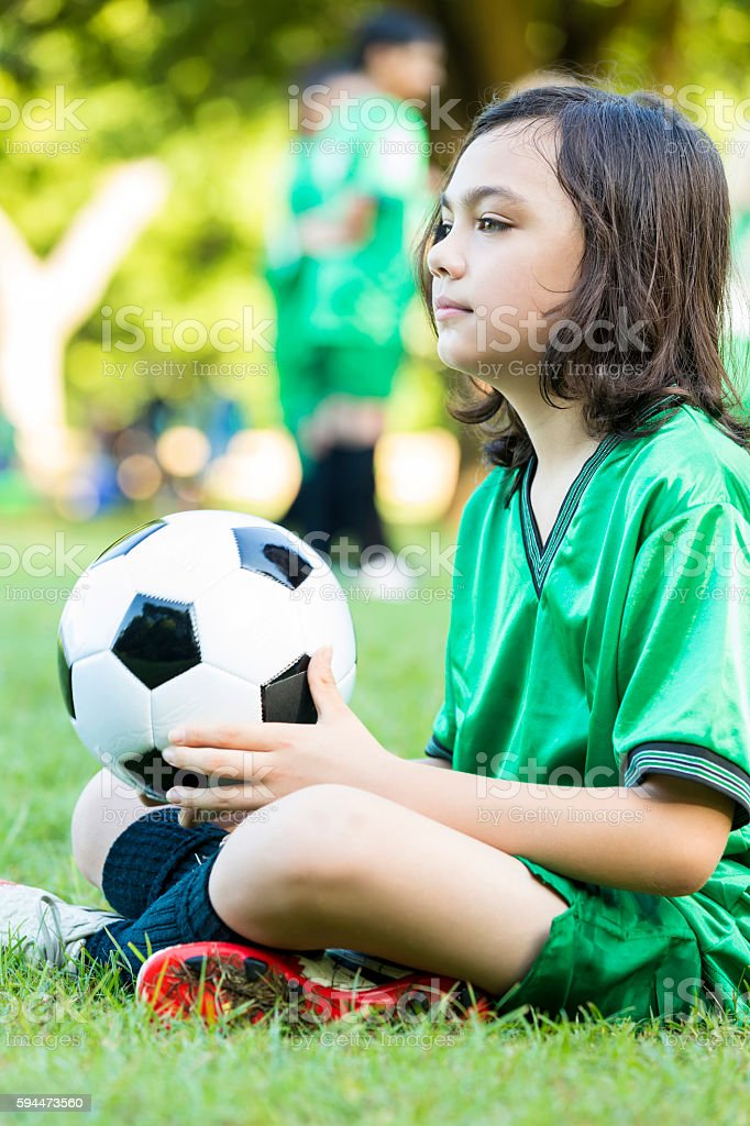 Thoughtful soccer player before game stock photo