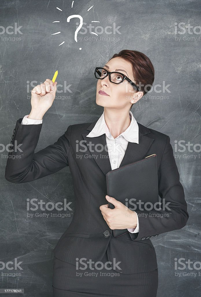 Thoughtful teacher with question sign royalty-free stock photo