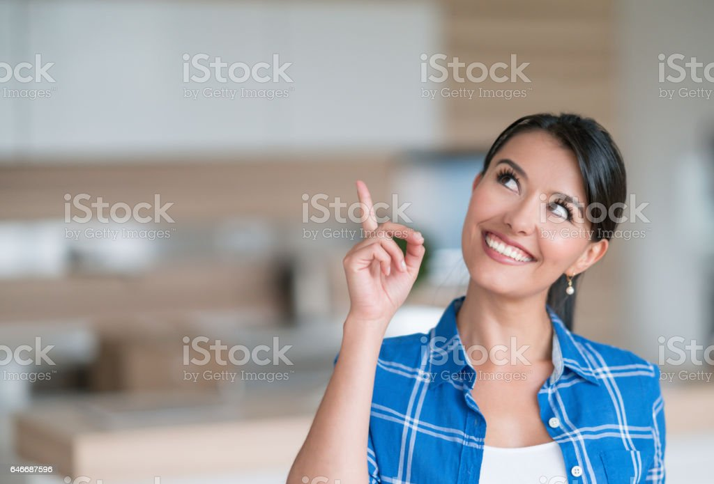 Thoughtful woman at an empty apartment stock photo