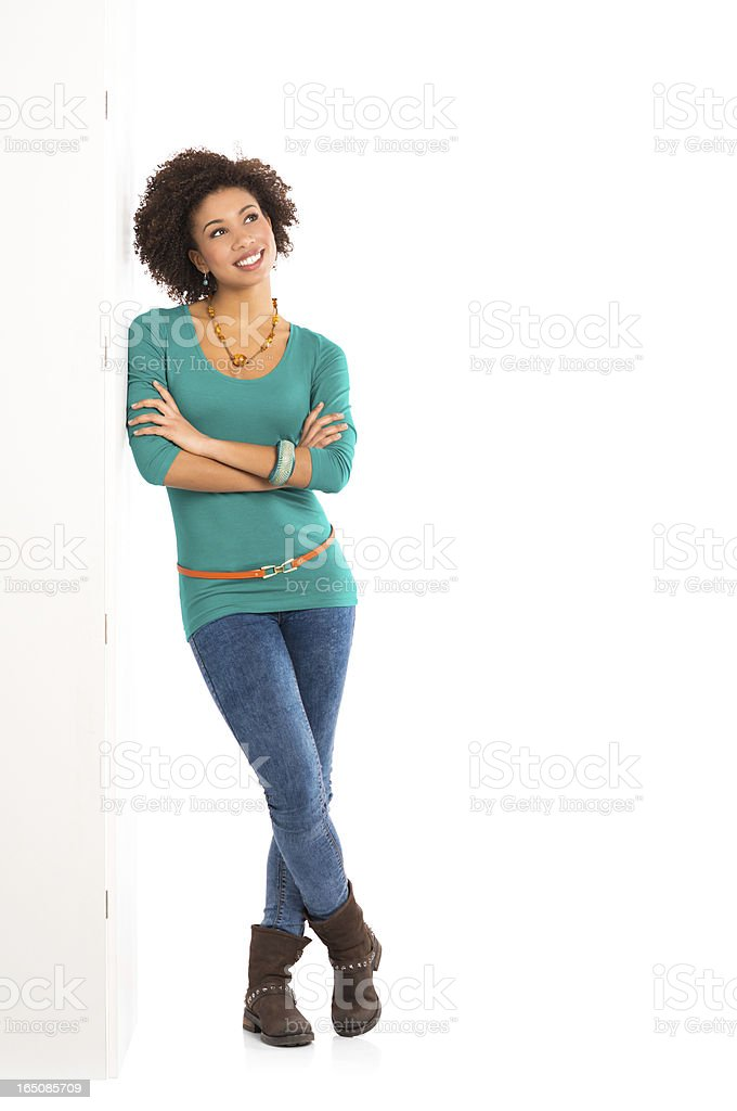 Thoughtful Woman Leaning On Wall stock photo