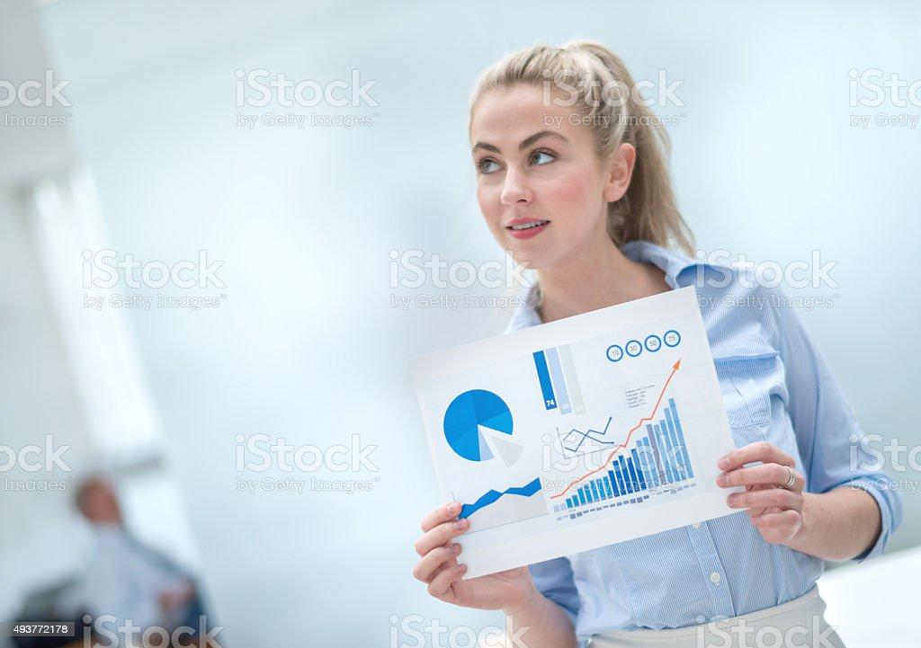 Thoughtful woman making a business presentation stock photo