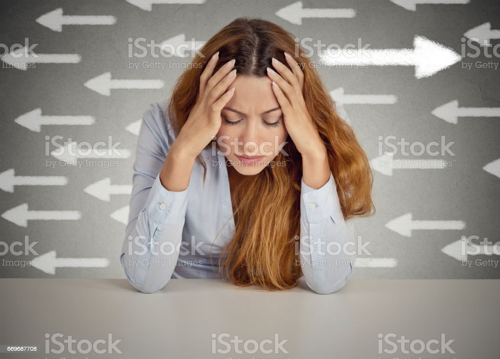 Thoughtful woman taking a chance going against flow. stock photo