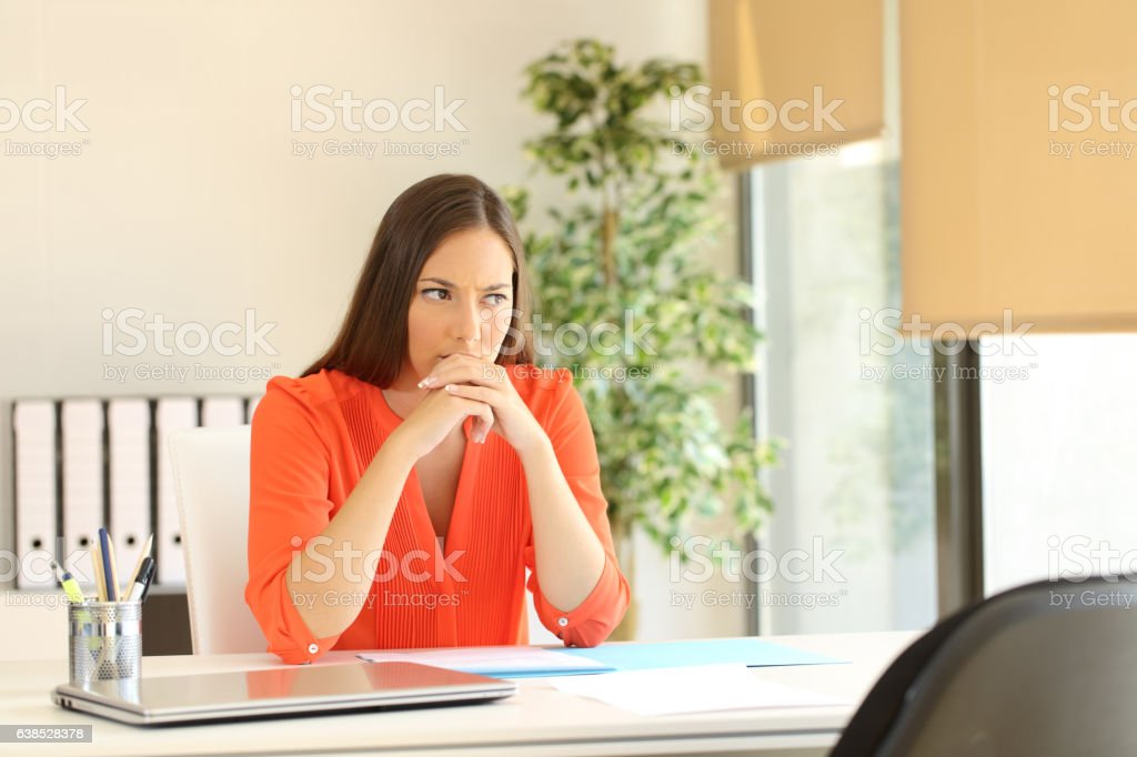 Thoughtful woman waiting for a job interview stock photo