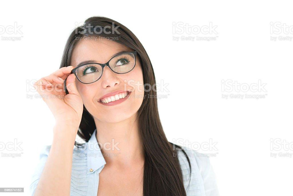 Thoughtful woman wearing glasses stock photo
