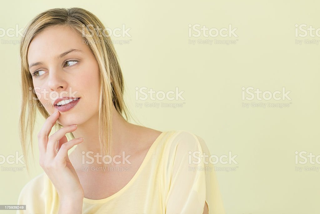 Thoughtful Woman With Hand On Chin Looking Away royalty-free stock photo