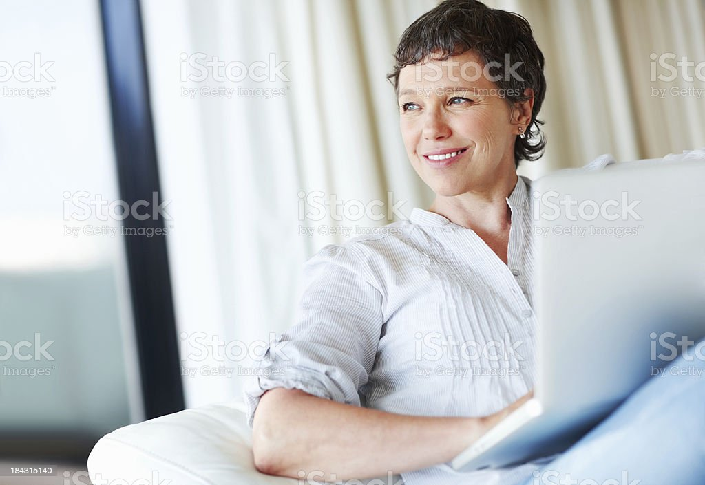 Thoughtful woman with laptop royalty-free stock photo