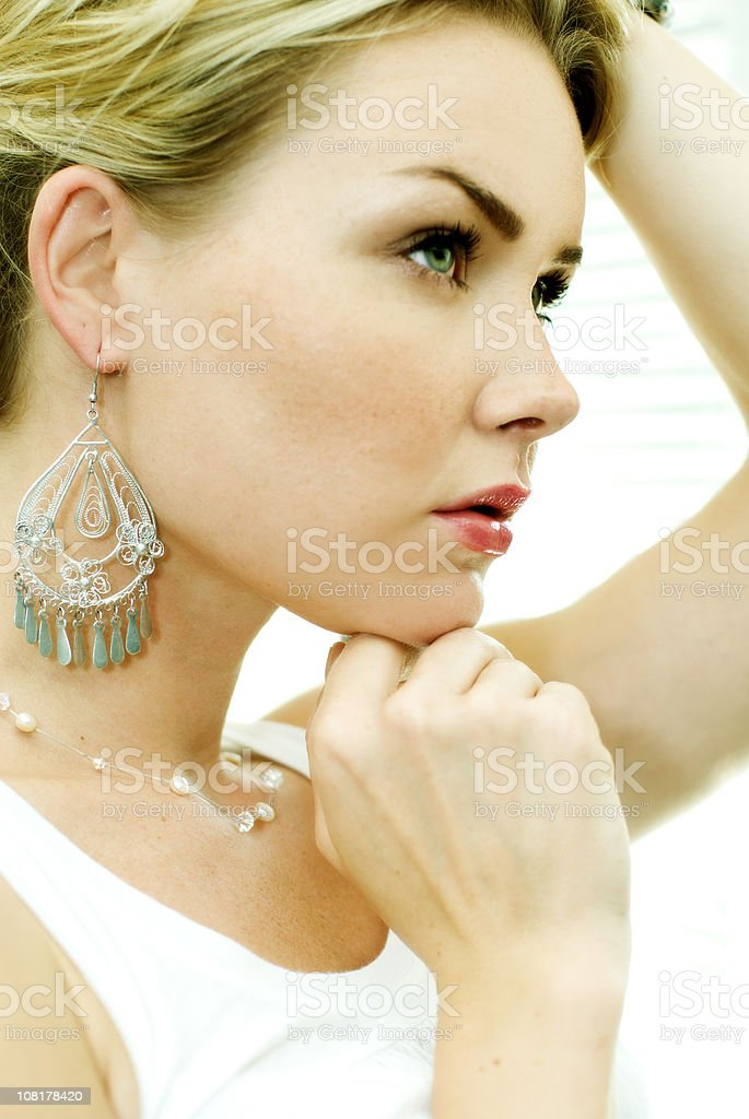 THoughtful women with earings royalty-free stock photo