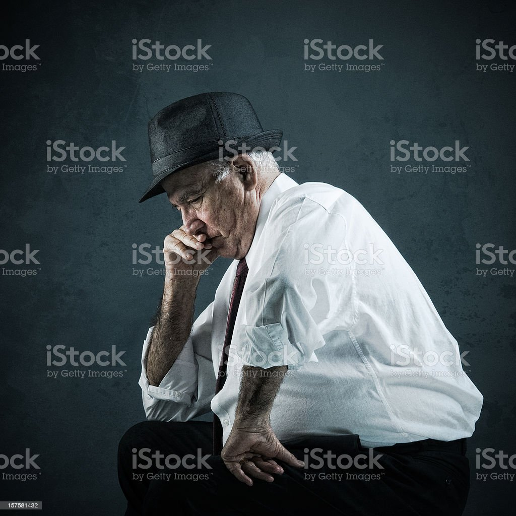 thoughtful worried senior stock photo