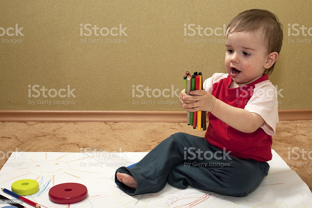 Thoughtful young artist with felt-tip pens royalty-free stock photo