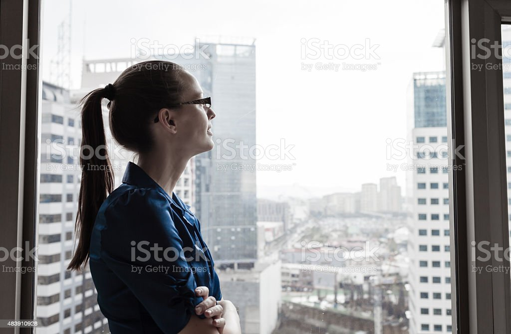 Thoughtful young businesswoman stock photo
