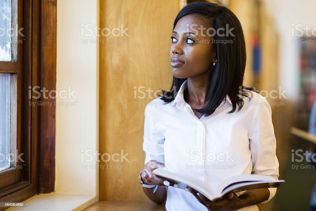 thoughtful young female african college student stock photo