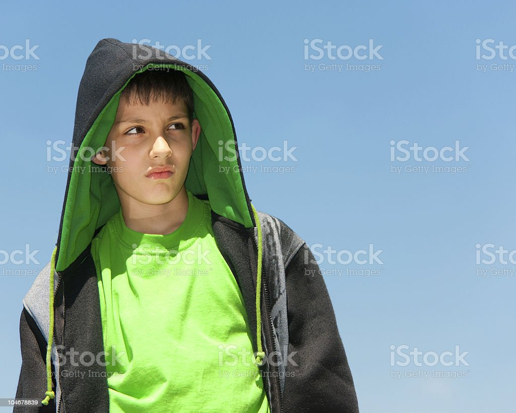 Thoughtful young hip-hop dancer outdoors royalty-free stock photo
