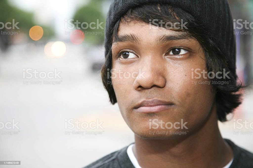 Thoughtful Young Man on the Street, with Copy Space royalty-free stock photo