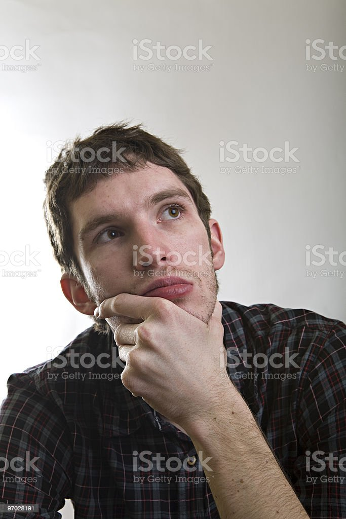 Thoughtful young man royalty-free stock photo