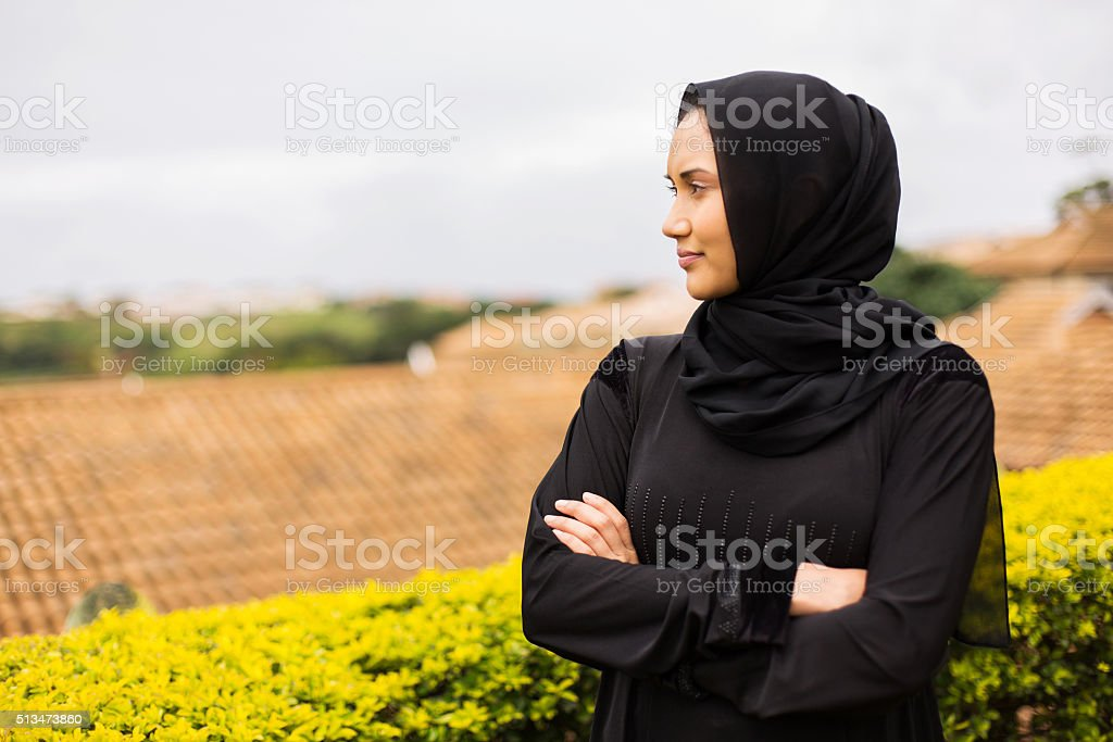 thoughtful young muslim woman stock photo