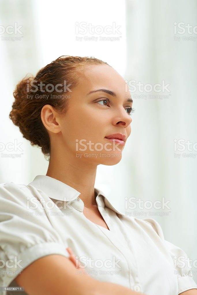 Thoughtful young woman looking away stock photo