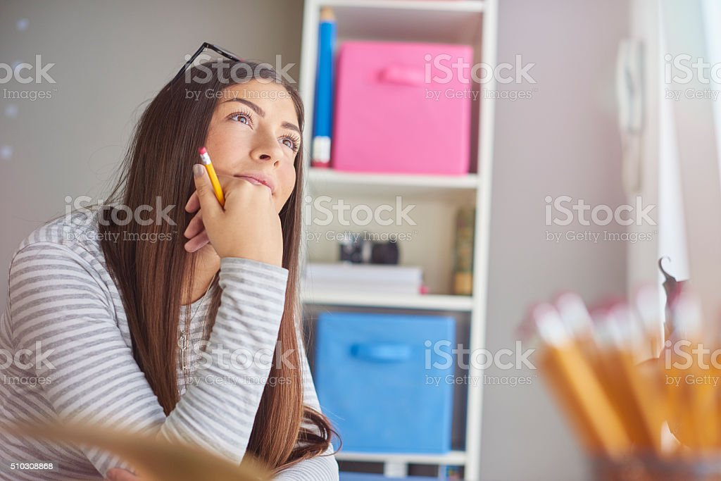 thoughtful young woman stock photo