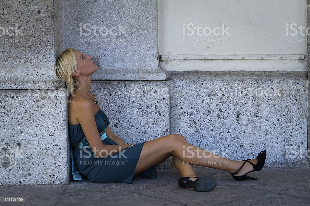 Thoughtful Young Woman Sitting And Looking Away stock photo