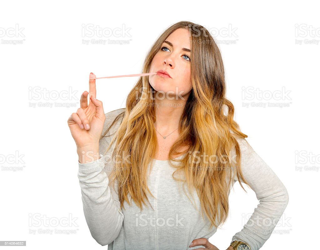 Thoughtless woman chewing gum stock photo