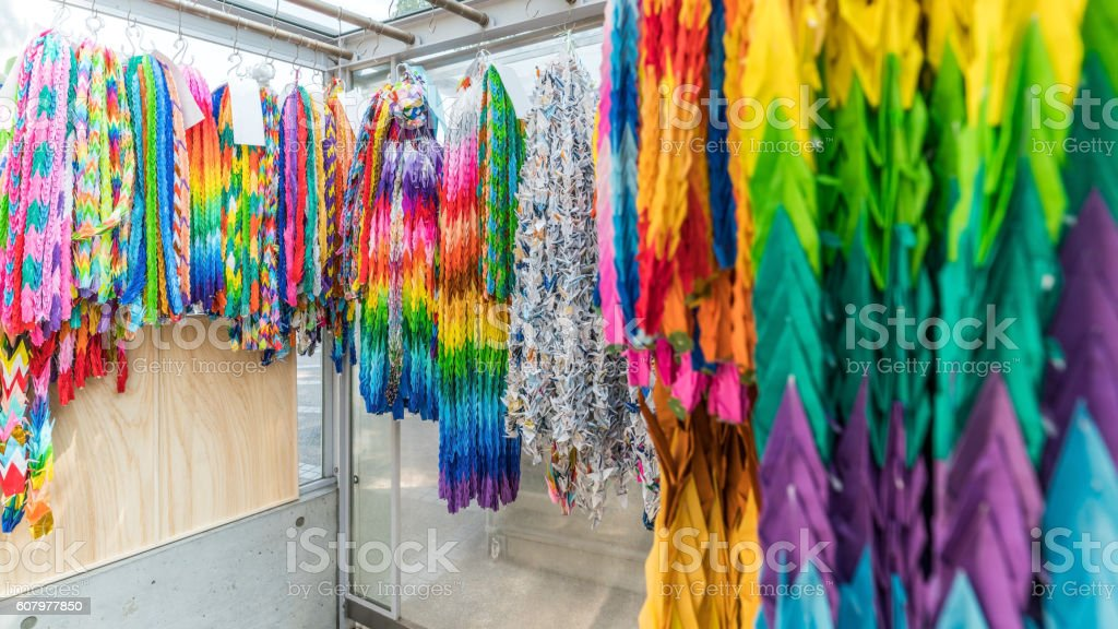 Thousands of colorful origami cranes stock photo