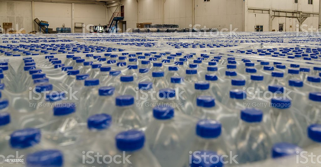 Thousands of water bottles are stored in warehouse stock photo