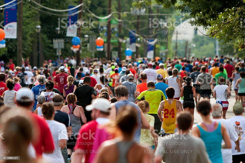 Thousands Run Toward Finish Line Of Atlanta Peachtree Road Race stock photo