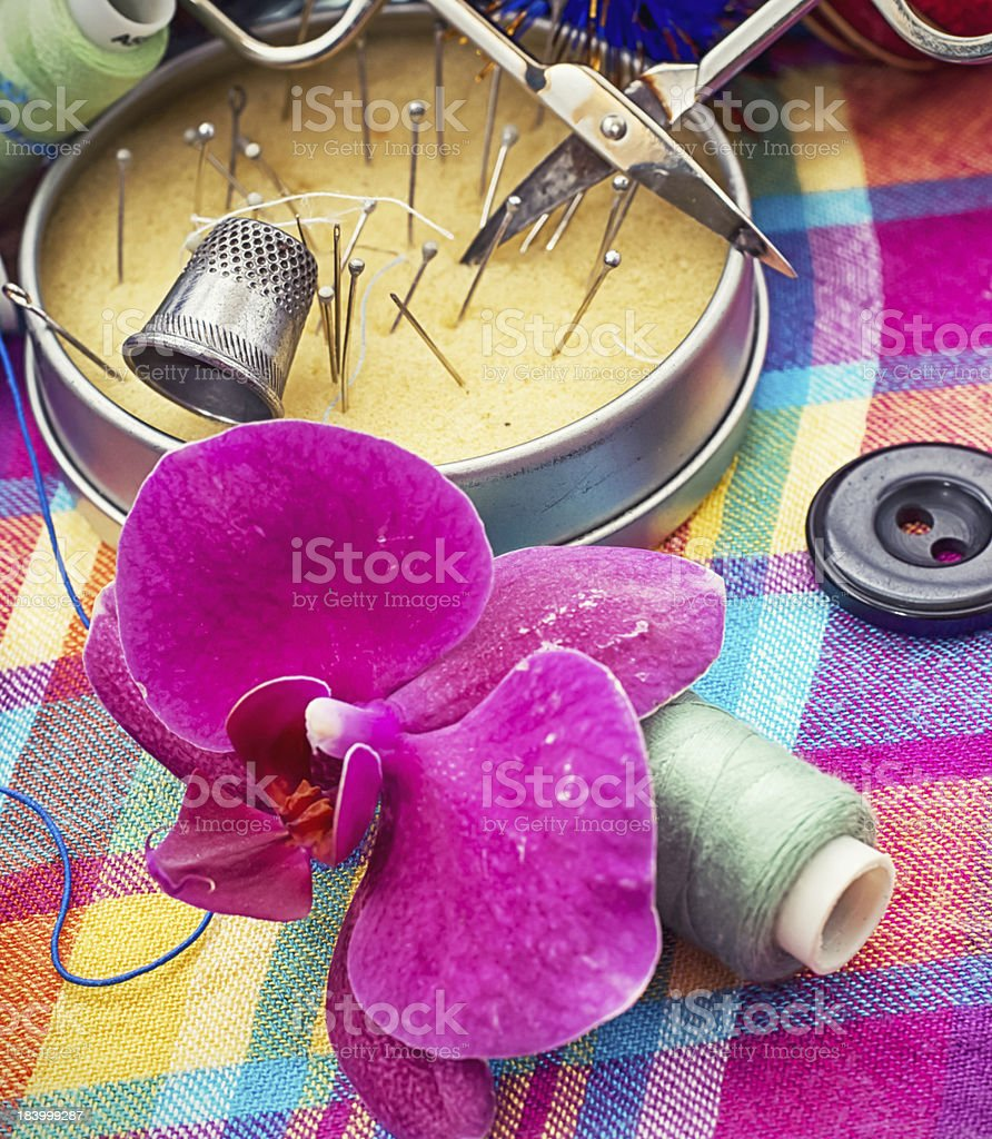 thread and needles on the background of Orchid flower royalty-free stock photo