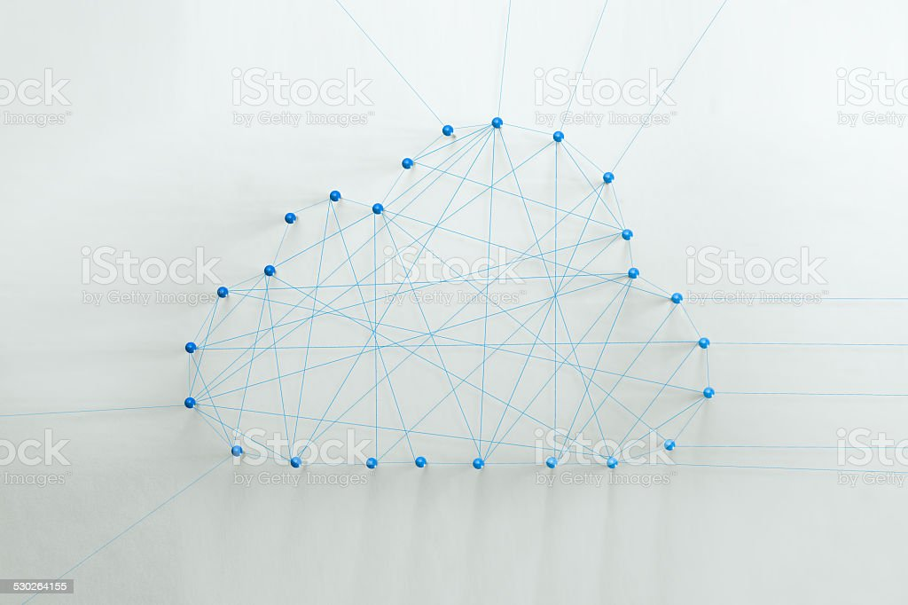 thread and pin made cloud shape stock photo