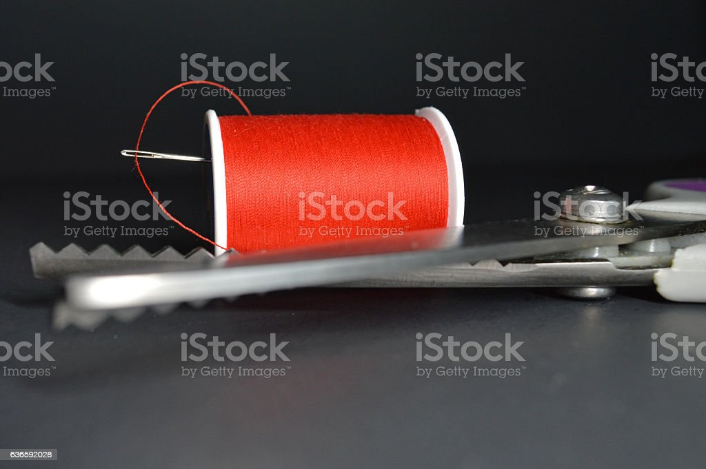 Thread and pinking shears stock photo