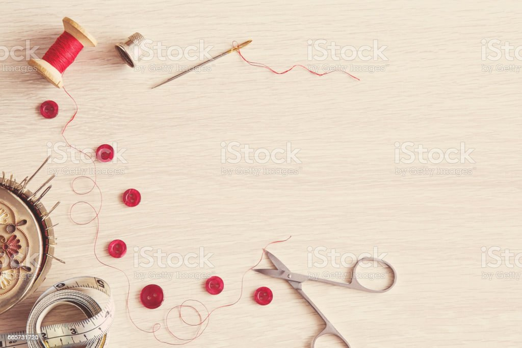 Thread, needle, scissors and buttons - basic accessories starting sewing. Sewing works. Handmade. Womanly hobby. stock photo