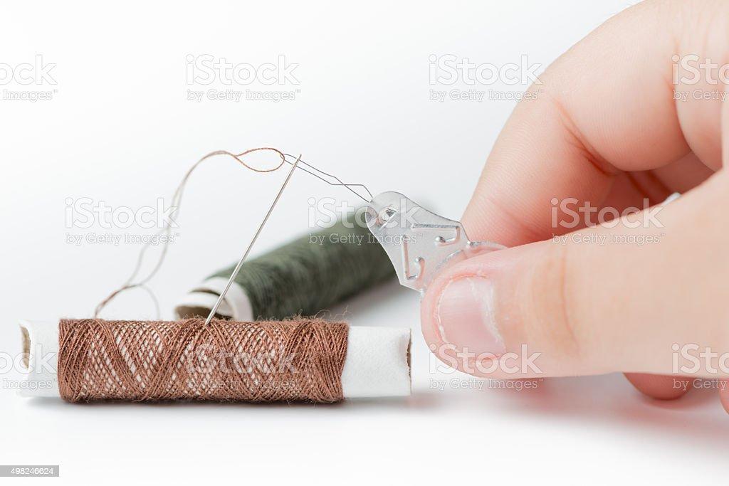 thread needles on boy hand stock photo