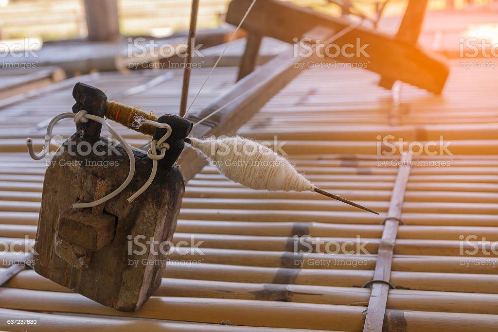 thread of yarn on traditional loom stock photo