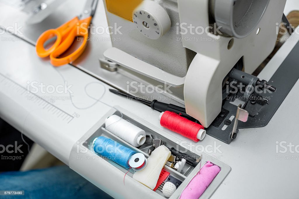 thread, scissors and sewing machine stock photo